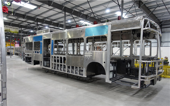 A bare bus frame at BYD's Lancaster, California factory. Image credit: Kyle Field | CleanTechnica