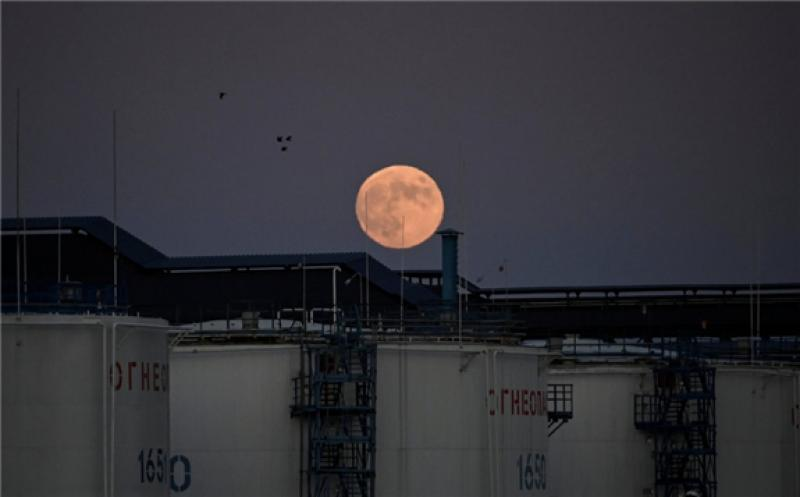 Storage tanks behind the oil refinery in Omsk, Russia. In April, Russia, Saudi Arabia and other producers agreed to cut production by a record 9.7 million barrels a day.Credit...Alexey Malgavko/Reuters