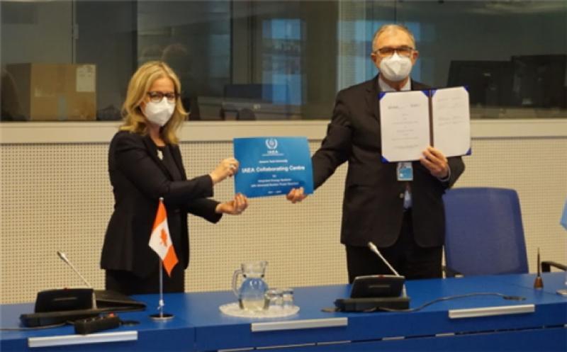 Heidi Hulan, Canada's ambassador to Austria, and Mikhail Chudakov, IAEA deputy director general, at the signing of the IAEA Collaborating Centre agreement (Image: H Subki/IAEA)