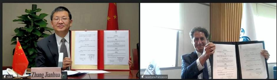 National Energy Administration administrator Zhang Jianhua and Irena director general Francesco La Camera hold up signed partnership agreements. Courtesy Irena