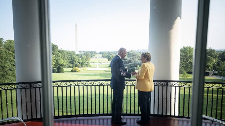 handout photo provided by the German Government Press Office of German Chancellor Angela Merkel and U.S. President Joe Biden stand in the White House with a view of the Washington Monument on July 15, 2021 in Washington, DC. Guido Bergmann | Handout | Getty Images News | Getty Images
