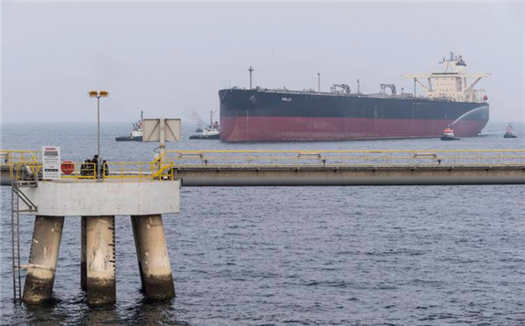 VLCC or Very Large Crude Carrier docks at the Fujairah Oil Tanker Terminal VLCC Birth 1 jetty in the Port of Fujairah. Opec+ has begun to taper a historic production restriction pact and plans to bring 2 million bpd back to the markets by the end of the year. Antonie Robertson/The National